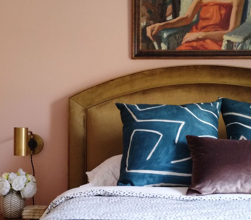 Guest bedroom makeover mood board with bold earthy colors